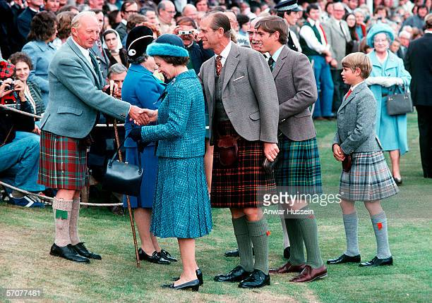 Queen Elizabeth II with Prince Phillip the Duke of Edinburgh and Princes Andrew and Edward with the Queen Mother in the back ground at the Braemar...