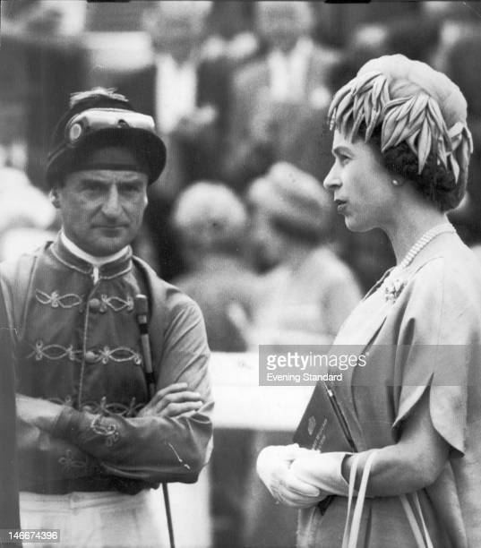 Queen Elizabeth II with royal jockey Harry Carr at Goodwood racecourse UK 2nd August 1963