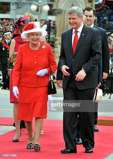 Queen Elizabeth II with Stephen Harper the Prime Minister of Canada outside the Parliament Building after arriving to attend the Canada Day...