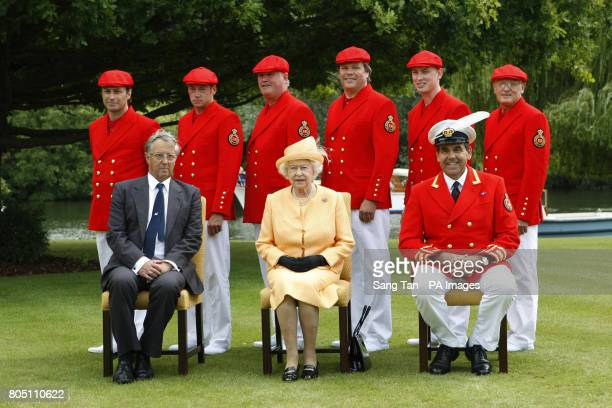 Queen Elizabeth II with Swan Warden Professor Christopher Perrins and her team of Swan Uppers lead by Swan Marker David Barber at Oakley Court near...