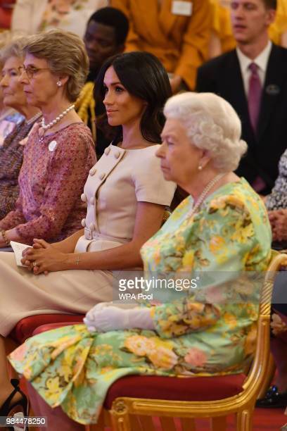 Queen Elizabeth II with the Duchess of Sussex at the Queen's Young Leaders Awards Ceremony at Buckingham Palace on June 26 2018 in London England The...