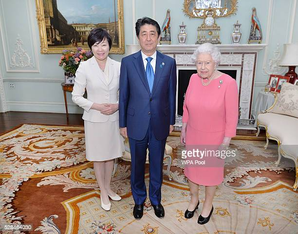Queen Elizabeth II with the Prime Minister of Japan Shinzo Abe and wife Akie after they arrived for a private audience at Buckingham Palace on May 4...