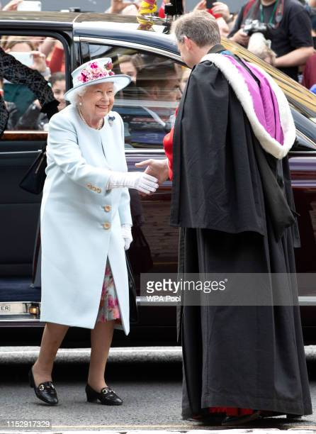 Queen Elizabeth II with the Reverend Neil Gardner as she arrives at Canongate Kirk in Edinburgh for the Sunday church service on June 30 2019 in...
