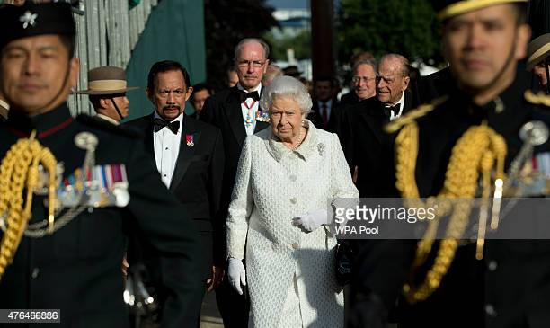 Queen Elizabeth II with the Sultan of Brunei arrive at the Gurkha 200 pageant in the grounds of the Royal Hospital Chelsea on June 9 2015 in London...