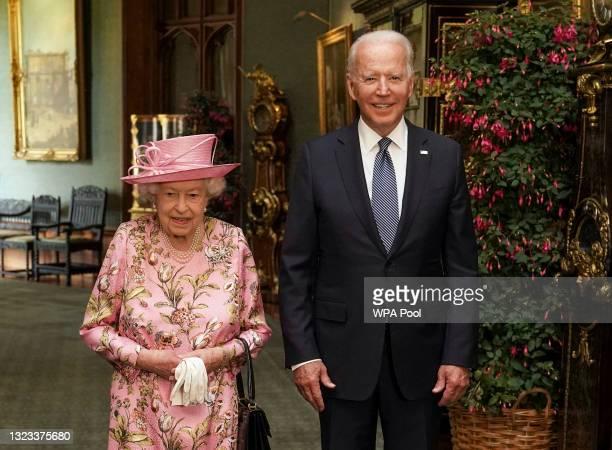 Queen Elizabeth II with US President Joe Biden in the Grand Corridor during their visit to Windsor Castle on June 13, 2021 in Windsor, England. Queen...