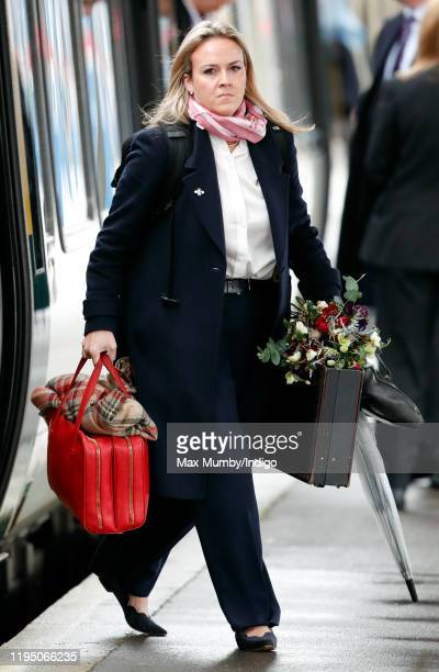 Queen Elizabeth II's briefcases, blanket and flowers seen being carried off the train as she arrives at King's Lynn railway station, after taking the...