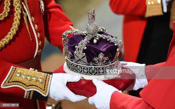 Queen Elizabeth II's crown is prepared before the State Opening of Parliament in the House of Lords at the Palace of Westminster on May 18, 2016 in...