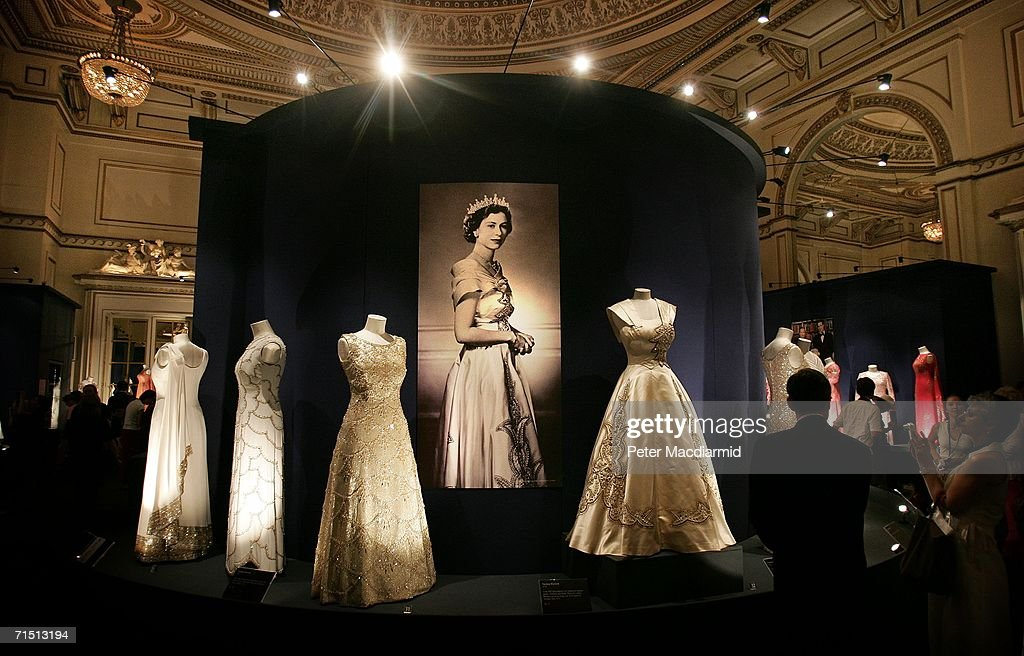Queen Elizabeth Ii S Dresses And Jewellery Are Displayed At Buckingham Palace On July 25 2006