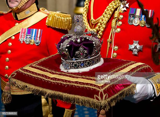 Queen Elizabeth II's Imperial State Crown is carried through Norman Porch ahead of the State Opening of Parliament in the House of Lords at the...