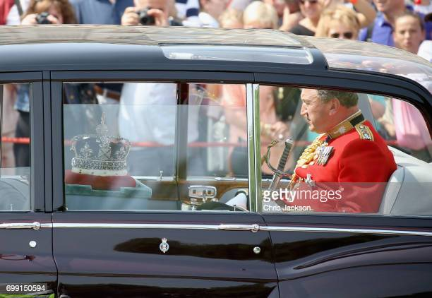 Queen Elizabeth II's Imperial State Crown is driven from Buckingham Palace to the House of Lords at the Palace of Westminster ahead of the State...