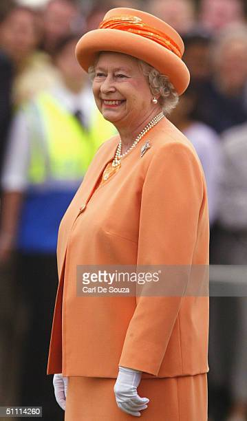 Queen Elizabeth in buoyant mood at the Guards Polo Club on July 25 2004 in Windsor England She presented the prizes for the Cartier International...