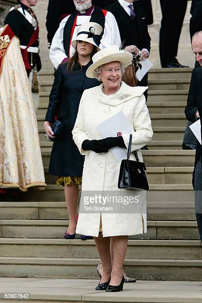 Queen Elizabeth in cream outfit leaves the Service of Prayer and Dedication blessing the marriage of the Prince of Wales Prince Charles and the...
