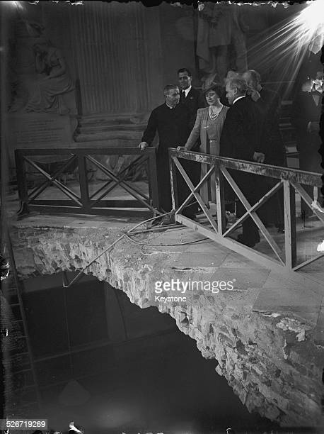 Queen Elizabeth inspects a large hole in the floor of St Paul's Cathedral made by a bomb dropped in a German air raid London 11th June 1941 The bomb...