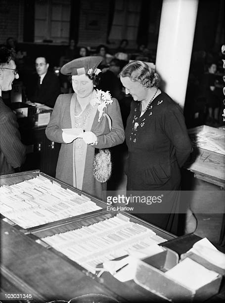 Queen Elizabeth inspects the files at Blythe House the headquarters of the Post Office Savings Bank in West Kensington London 5th March 1942 Work is...