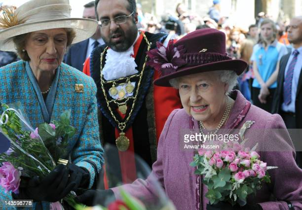 Queen Elizabeth ll accompanied by her ladyinwaiting Diana Lady Farnham undertakes a walkabout to mark her Diamond Jubilee on April 30 2012 in Windsor...