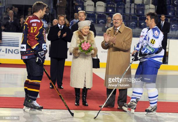 Queen Elizabeth ll accompanied by President Ivan Gasparovic prepares to start an ice hockey match between Aqua City Poprad and Guildford Flames at...