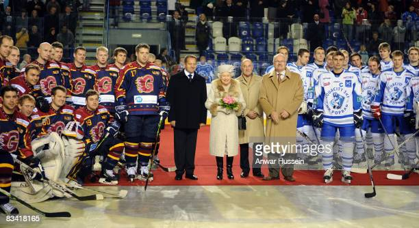 Queen Elizabeth ll, accompanied by President Ivan Gasparovic, prepares to start an ice hockey match between Aqua City Poprad and Guildford Flames at...
