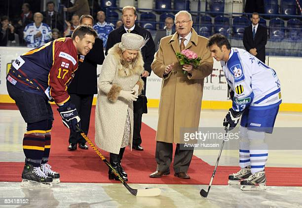 Queen Elizabeth ll, accompanied by President Ivan Gasparovic, throws in the puck to start an ice hockey match between Aqua City Poprad and Guildford...