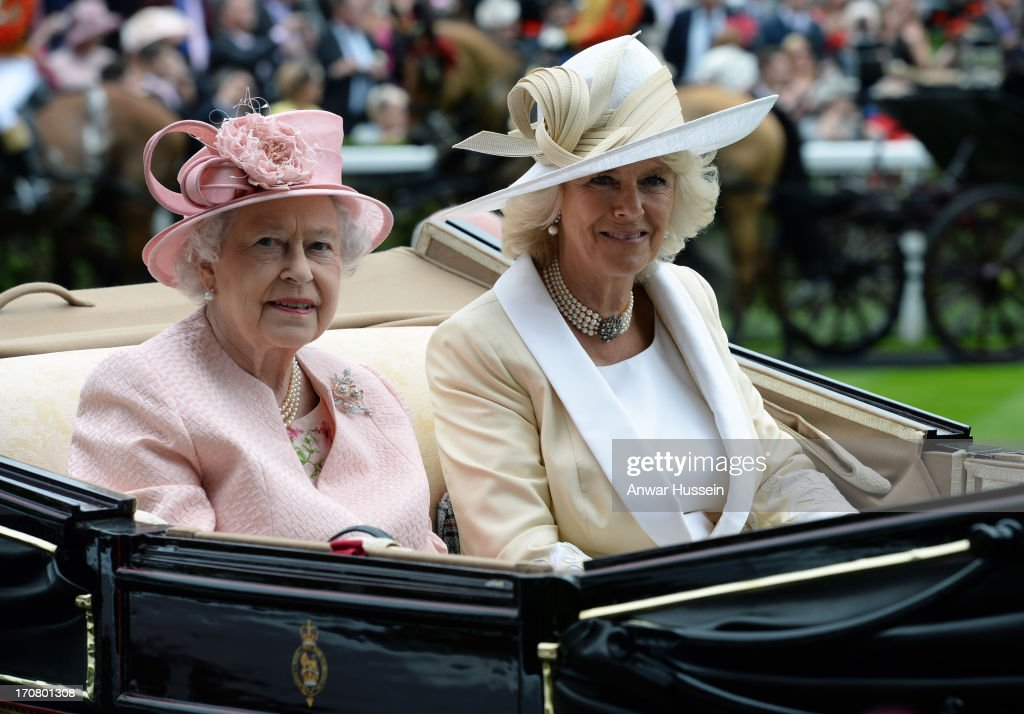 Queen Elizabeth ll and Camilla, Duchess of Cornwall arrive in an open carriage to attend Day 1 of Royal Ascot at Ascot Racecourse on June 18, 2013 in Ascot, England.