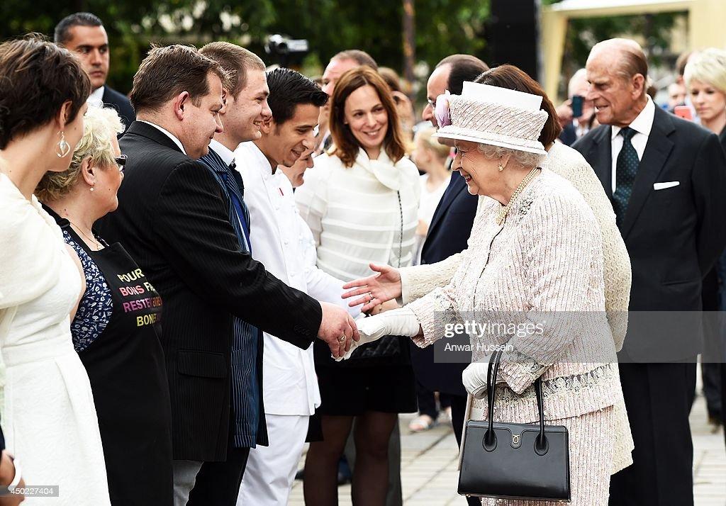 Queen Elizabeth ll and French President Francois Hollande meet wellwishers at the Marche aux Fleurs et aux Oiseaux on June 7, 2014 in Paris, France.