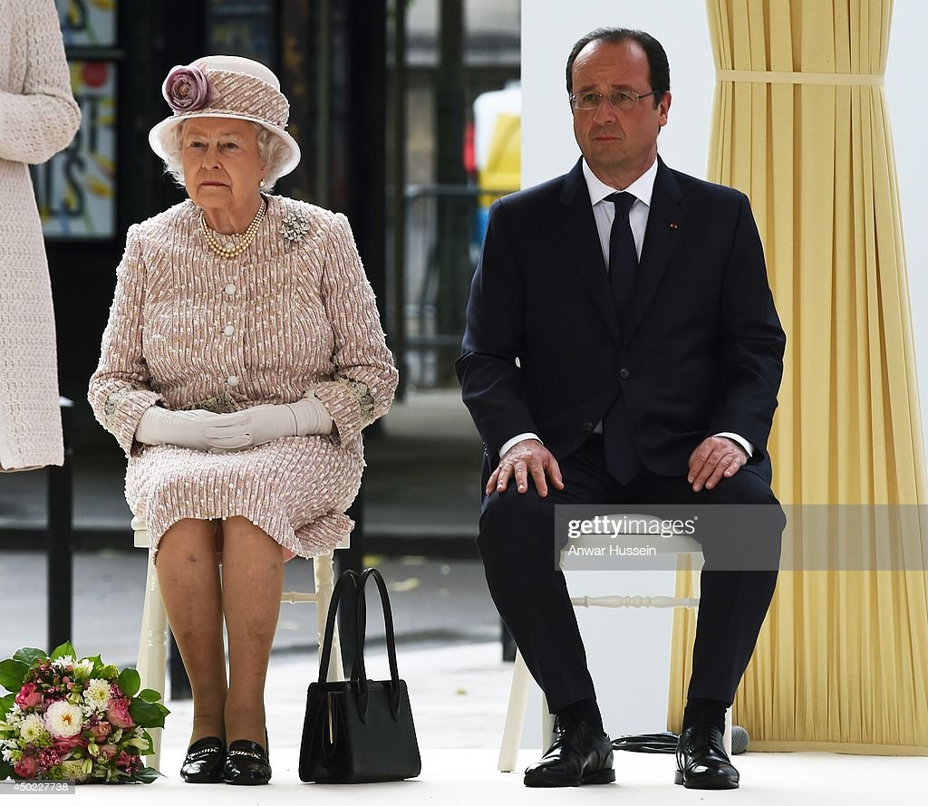 Queen Elizabeth ll and French President Francois Hollande sit together as they listen to a speech during a visit to the Marche aux Fleurs et aux Oiseaux on June 7, 2014 in Paris, France.