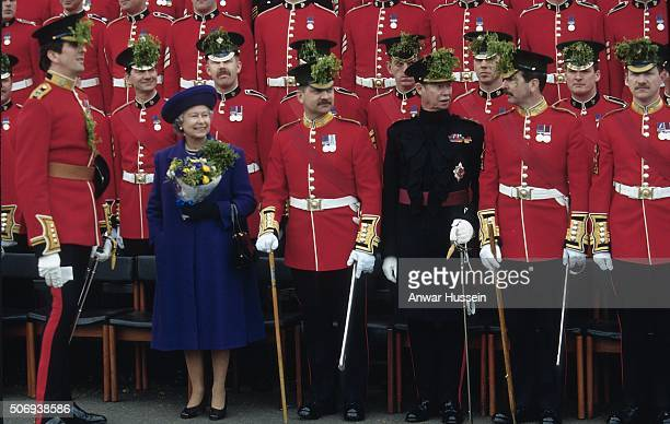 Queen Elizabeth ll and Grand Duke Jean of Luxembourg pose with the Irish Guards for a St Patrick's Day celebration on March 01 1995 in London England