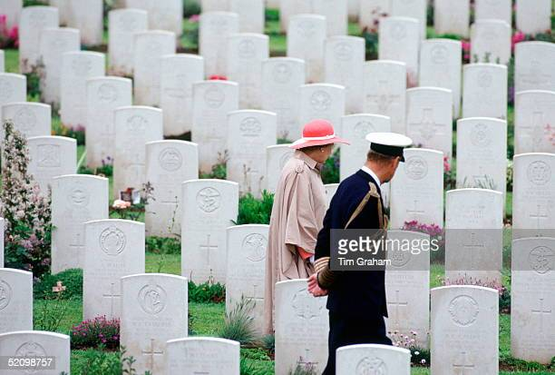 Queen Elizabeth Ll And Her Husband Prince Philip Walking Through The Commonwealth War Graves Before Attending A Service For The 50th Anniversary Of...