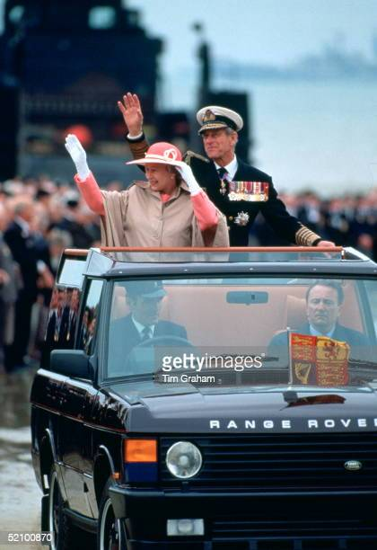Queen Elizabeth Ll And Her Husband Prince Philip Waving To Crowds Of Veterans From A Range Rover Car Before Attending A Service For The 50th...
