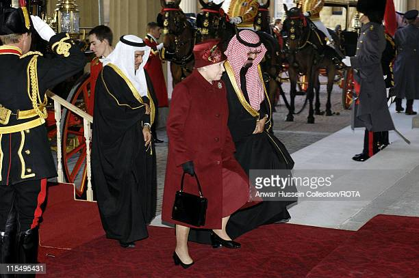Queen Elizabeth ll and King Abdullah of Saudi Arabia arrive at Buckingham Palace following a ceremonial welcome on October 30 2007 in London England