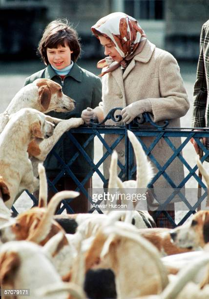 Queen Elizabeth ll and Lady Sarah ArmstrongJones meet the hounds at the Badminton Horse Trials in April 1973 in England