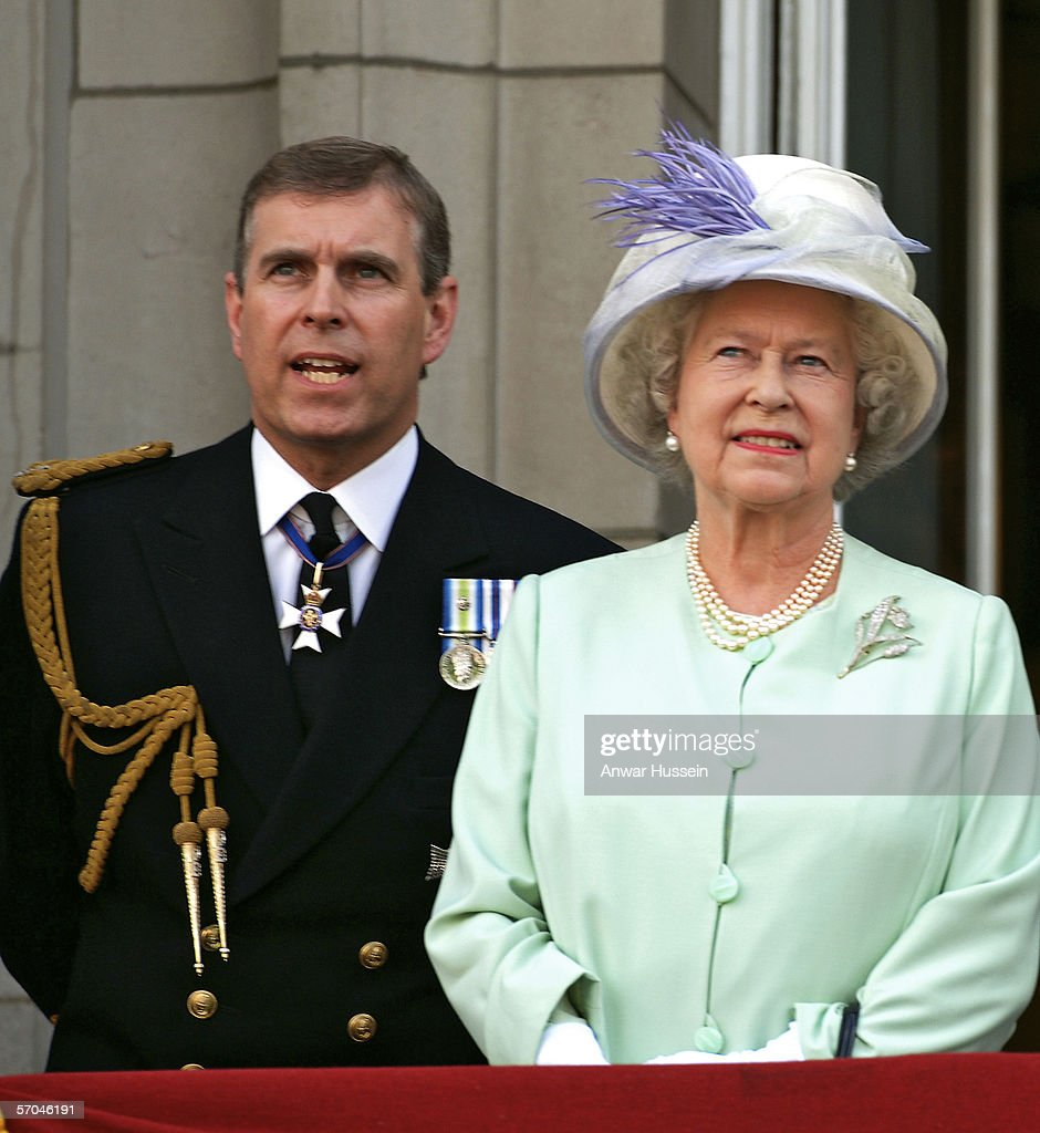 Queen Elizabeth ll and Prince Andrew the Duke of York watch the flypast over the Mall of British and US World War 11 aircraft from the balcony of Buckingham Palace on National Commemoration Day the 10th of July 2005.