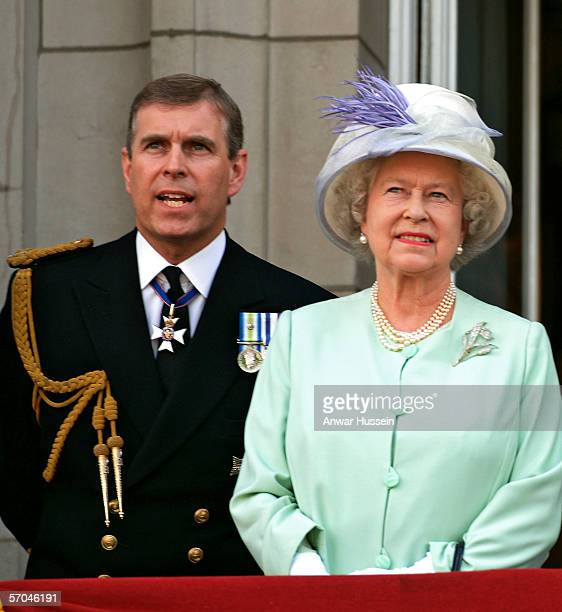 Queen Elizabeth ll and Prince Andrew the Duke of York watch the flypast over the Mall of British and US World War 11 aircraft from the balcony of...