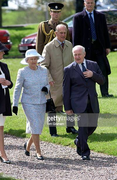 Queen Elizabeth Ll And Prince Philip Attending A Garden Party At Loughry Agricultural College The Northern Ireland Secretary Dr John Reid Is Talking...