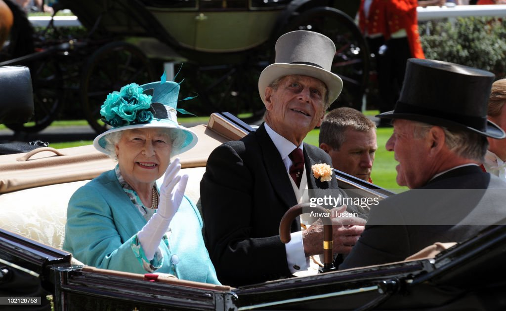 Queen Elizabeth ll and Prince Philip, Duke of Edinburgh arrive in an open carriage for the first day of Royal Ascot on June 15, 2010 in Ascot, England.
