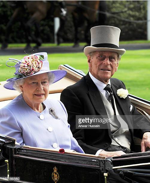 Queen Elizabeth ll and Prince Philip Duke of Edinburgh arrive in an open carriage on Ladies Day at Royal Ascot on June 17 2010 in Ascot England