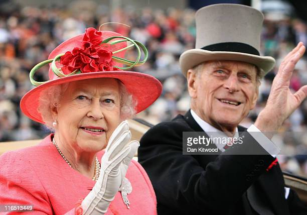 Queen Elizabeth ll and Prince Philip, Duke of Edinburgh arrive in an open carriage on Ladies Day at Royal Ascot on June 16, 2011 in Ascot, England....