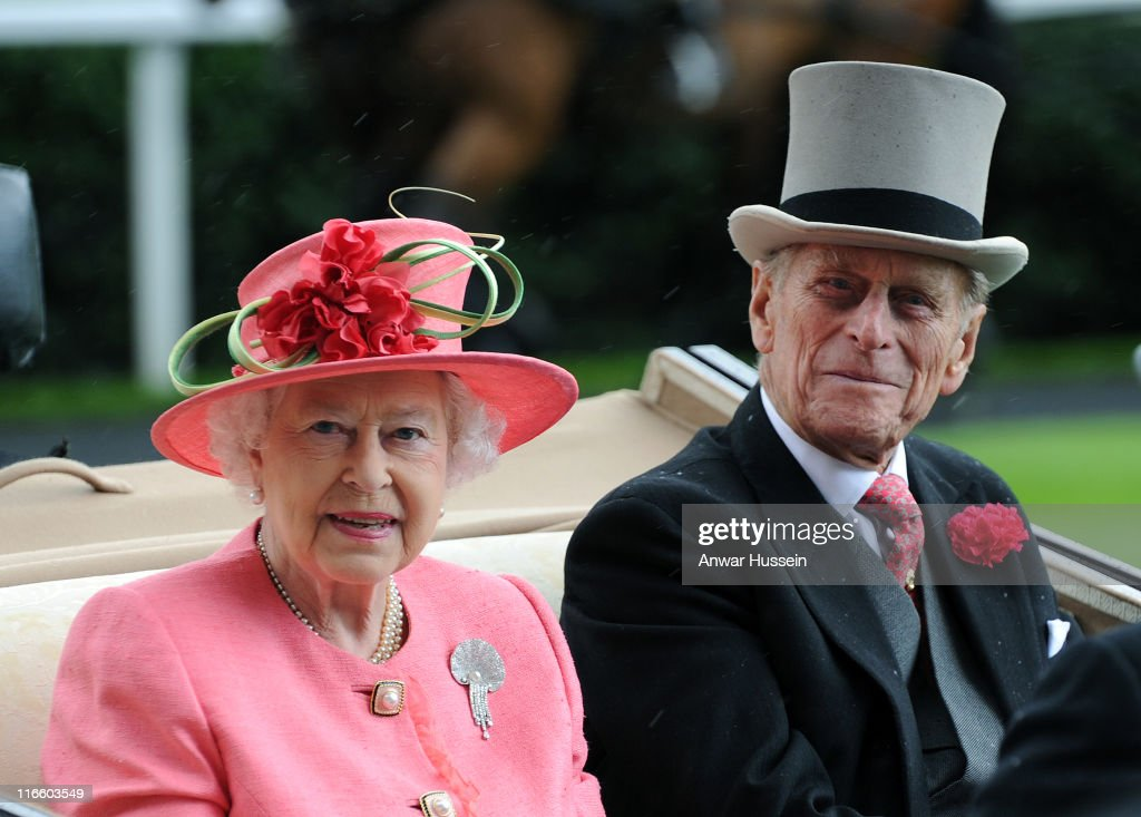 Queen Elizabeth ll and Prince Philip, Duke of Edinburgh arrive in an open carriage on Ladies Day at Royal Ascot on June 16, 2011 in Ascot, United Kingdom.