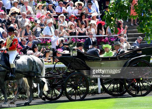 Queen Elizabeth ll and Prince Philip Duke of Edinburgh arrive in an open carriage to attend the first day off Royal Ascot 2017 at Ascot Racecourse on...