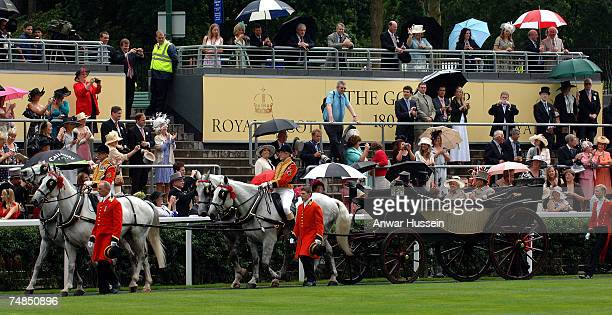 Queen Elizabeth ll and Prince Philip Duke of Edinburgh arrive in an open carriage during a rain shower for Ladies Day at Royal Ascot on June 21 2007...
