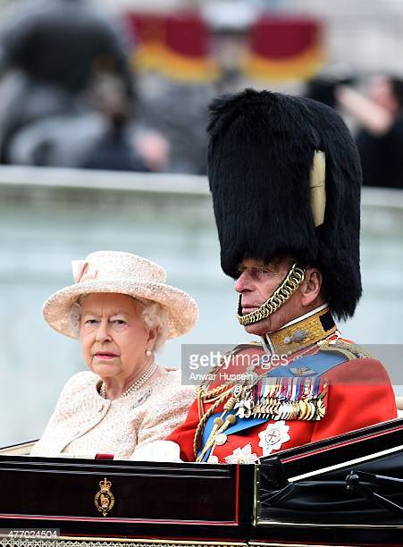 Queen Elizabeth ll and Prince Philip Duke of Edinburgh attend the Trooping the Colour Ceremony on June 13 2015 in London England