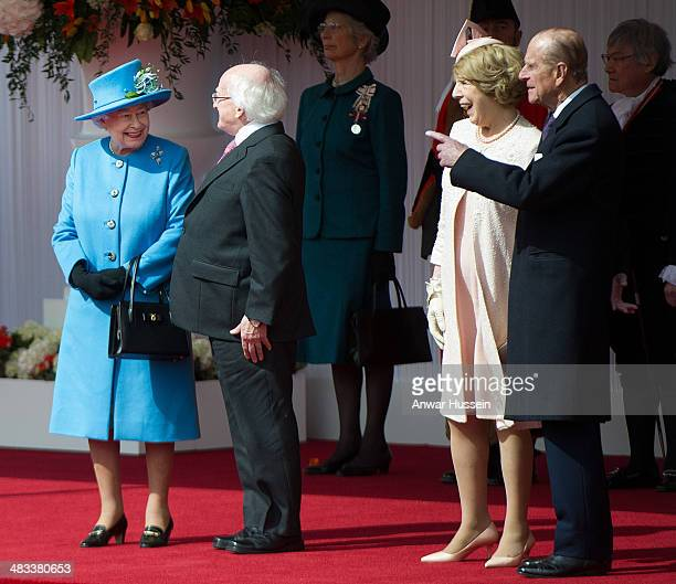 Queen Elizabeth ll and Prince Philip Duke of Edinburgh chat to the Irish President Michael D Higgins and Sabina Higgins during a ceremonial welcome...