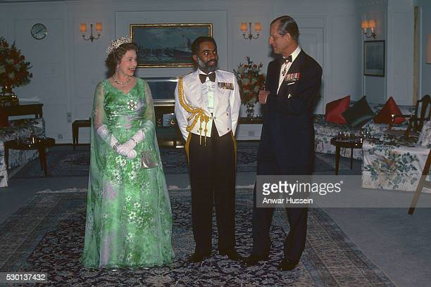 Queen Elizabeth ll and Prince Philip Duke of Edinburgh entertain Sultan Qaboos on board the royal Yacht Britannia during a State Visit to Oman on...