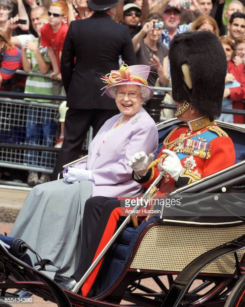 Queen Elizabeth ll and Prince Philip Duke of Edinburgh leave Buckingham Palace in an open carriage to attend the Trooping the Colour Ceremony on June...