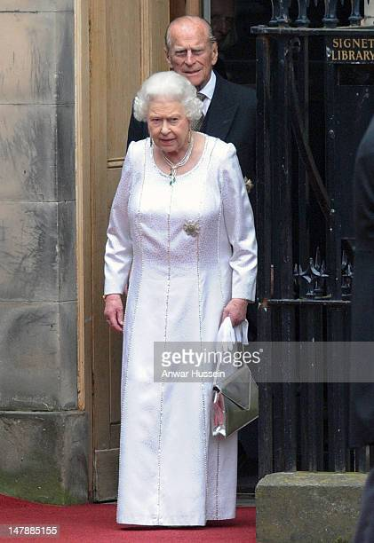 Queen Elizabeth ll and Prince Philip, Duke of Edinburgh leave following the Thistle Service for the installation of Prince William as a Knight of the...