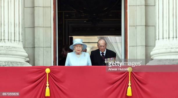 Queen Elizabeth ll and Prince Philip Duke of Edinburgh look out from the balcony of Buckingham Palace during the annual Trooping the Colour parade on...