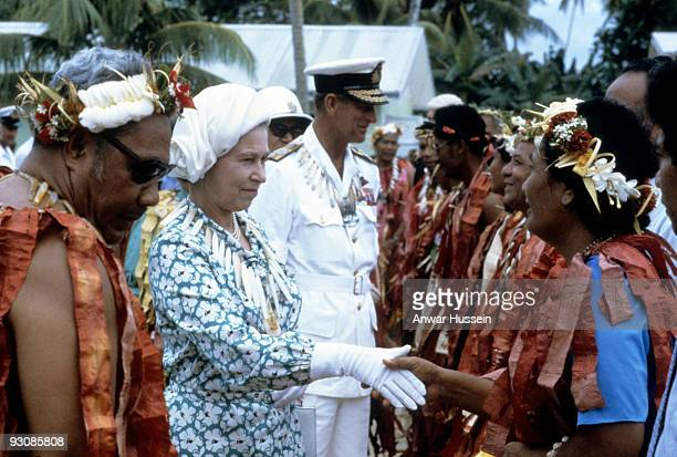 Queen Elizabeth ll and Prince Philip Duke of Edinburgh meet local dignitaries when they arrive in Tuvalu during their tour of the South Pacific on...