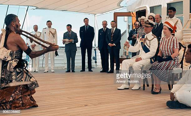 Queen Elizabeth ll and Prince Philip Duke of Edinburgh receive and are entertained by Fijian folk and traditional dancers on board the Royal Yacht...