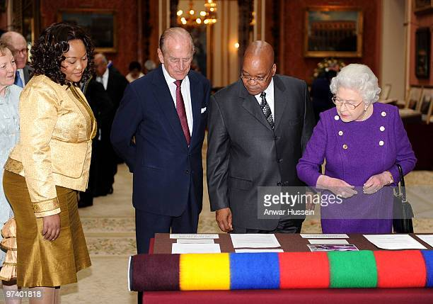 Queen Elizabeth ll and Prince Philip Duke of Edinburgh show South African President Jacob Zuma and wife Thobeka Madiba Zuma an exhibition of South...
