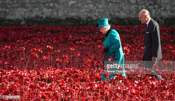 Queen Elizabeth ll and Prince Philip, Duke of Edinburgh view the ceramic poppies as they visit The Blood Swept Land and Seas of Red Poppies...
