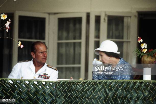 Queen Elizabeth ll and Prince Philipthe Duke of Edinburgh enjoy a cup of tea in Nauru during their tour of the South Pacific islands in October 1982